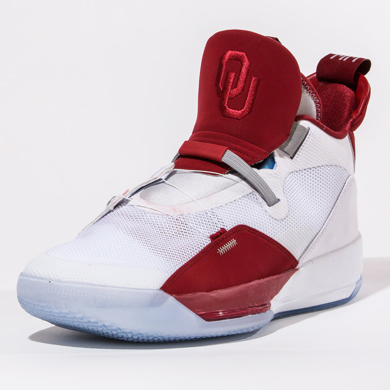 """... hoops programs will be rocking the new Jordan XXXIII. It s  predominantly a white sneaker with the classic """"OU"""" on an Oklahoma crimson  red tongue. 24815e2a8"""